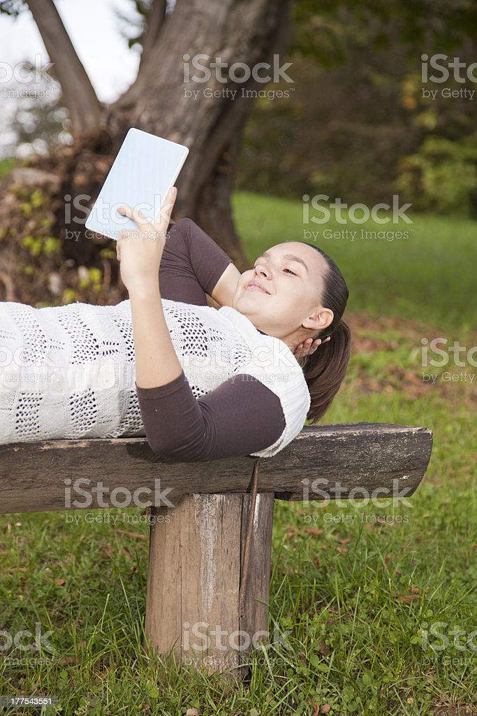 Cute girl with new tablet PC stock photo