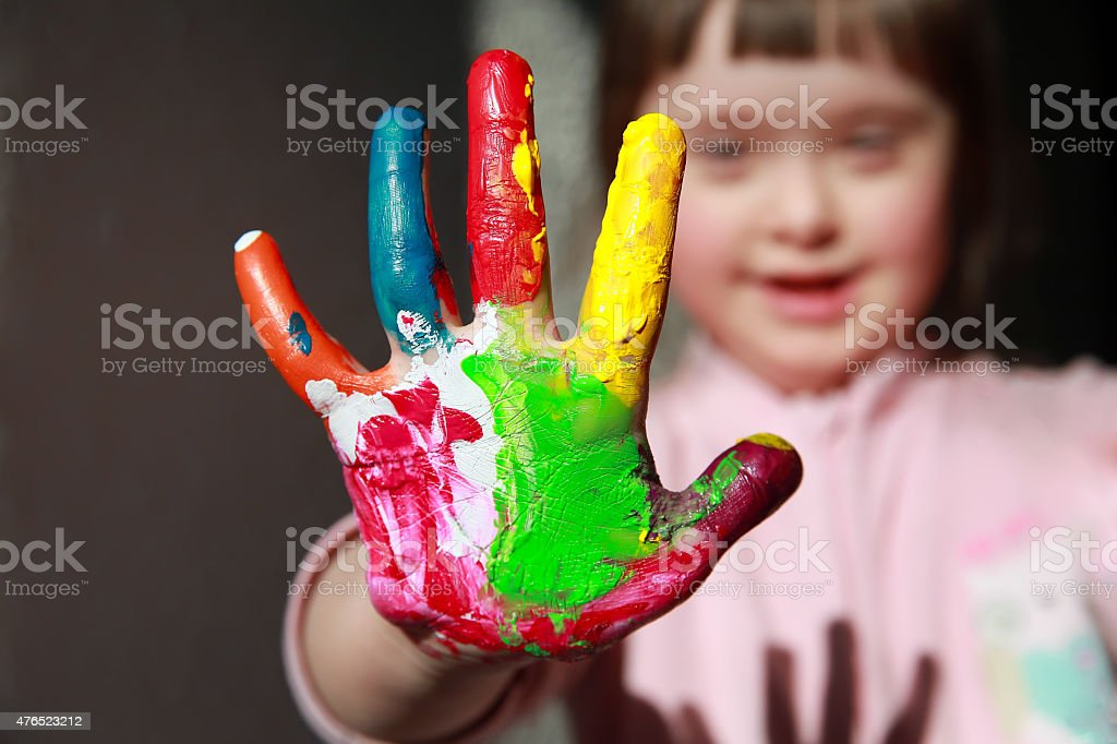 Cute girl with painted hand stock photo