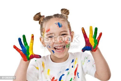 istock Cute girl with paited hands and face 810905810