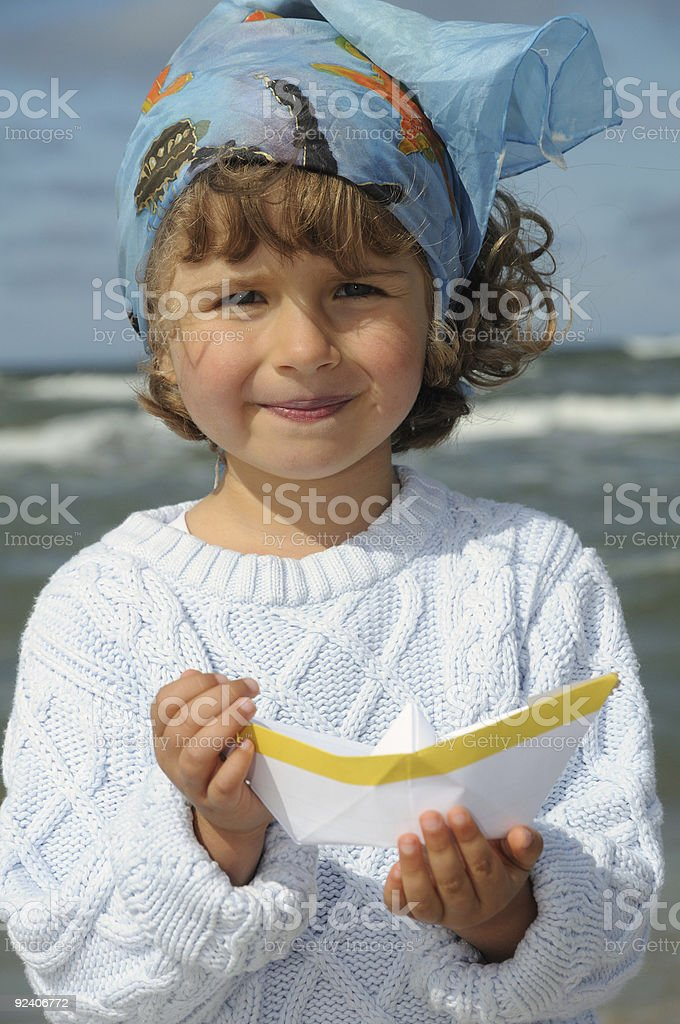 Cute girl with paper boat royalty-free stock photo
