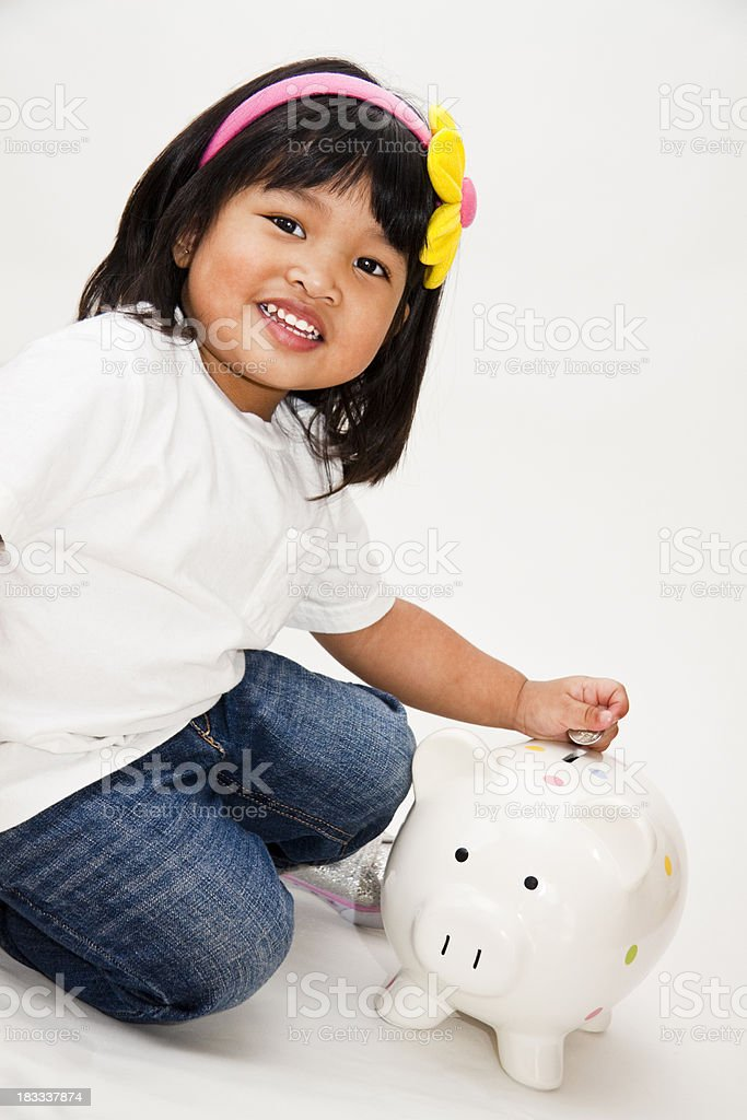 Cute Girl with Piggy Bank royalty-free stock photo