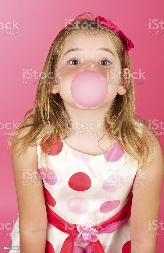 Cute Girl with Polka Dot Dress and Bubble Gum stock photo