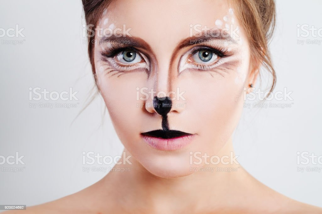 Cute Girl with Reindeer Animal Makeup. Face Closeup stock photo