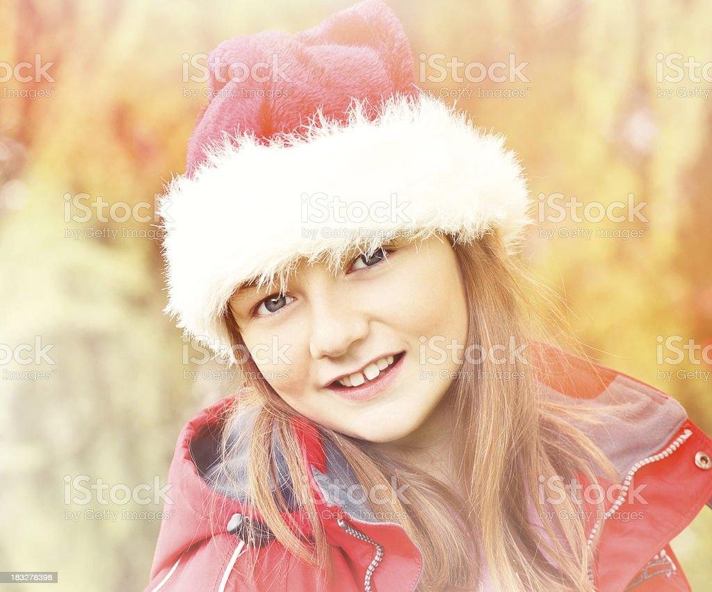 Cute girl with Santa hat. stock photo