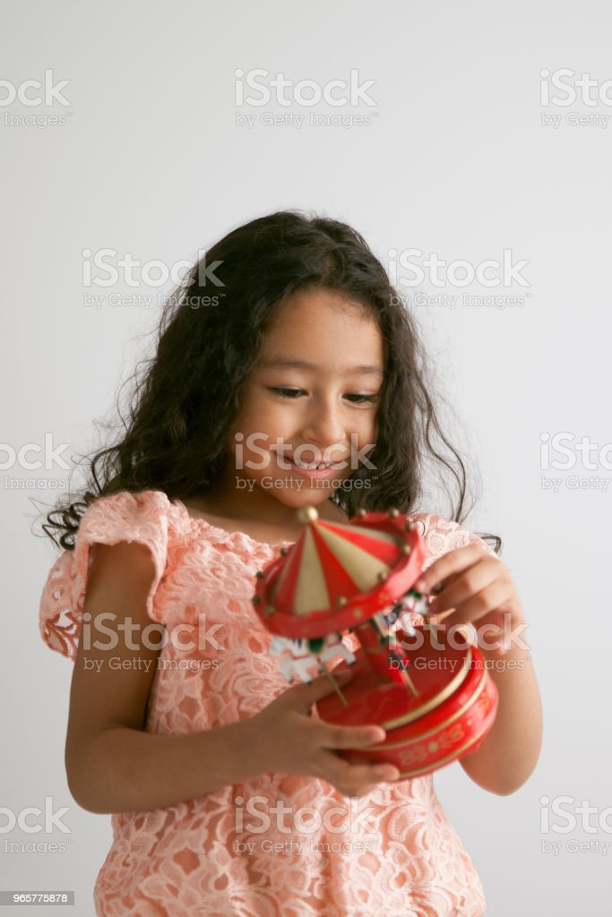 Cute Girl With Wooden Toy Carousel - Royalty-free 4-5 Years Stock Photo
