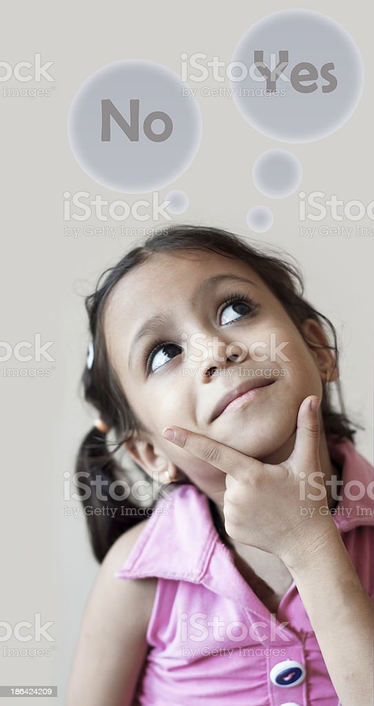 Cute girl with yes or no thought bubbles royalty-free stock photo