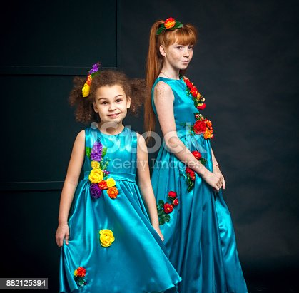 istock Cute Girls in Turquoise Dresses 882125394