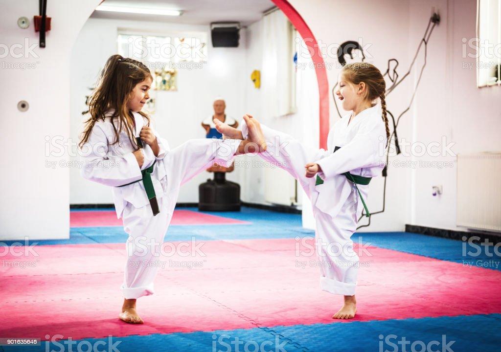 Cute girls on Taekwondo training stock photo