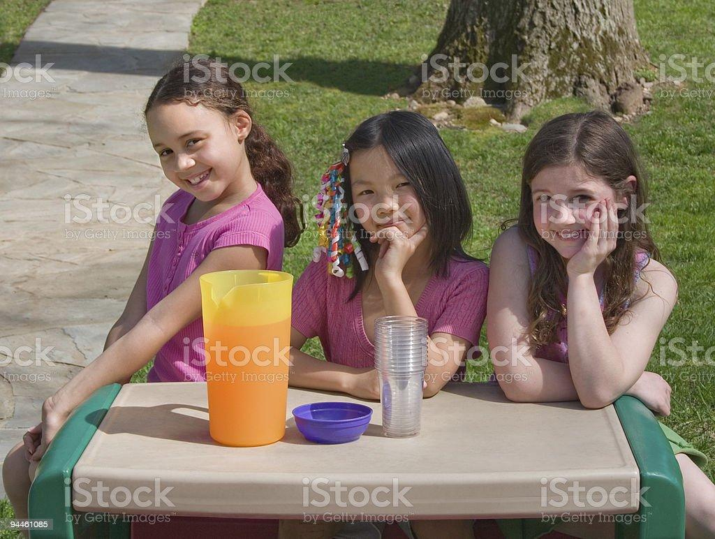 Cute Girls Selling Lemonade royalty-free stock photo
