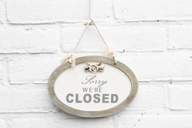 Cute hanging welcome board with text sorry we are closed today stock photo