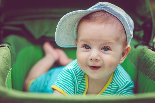 Cute Happy Baby Boy In Carriage Stock Photo - Download Image Now