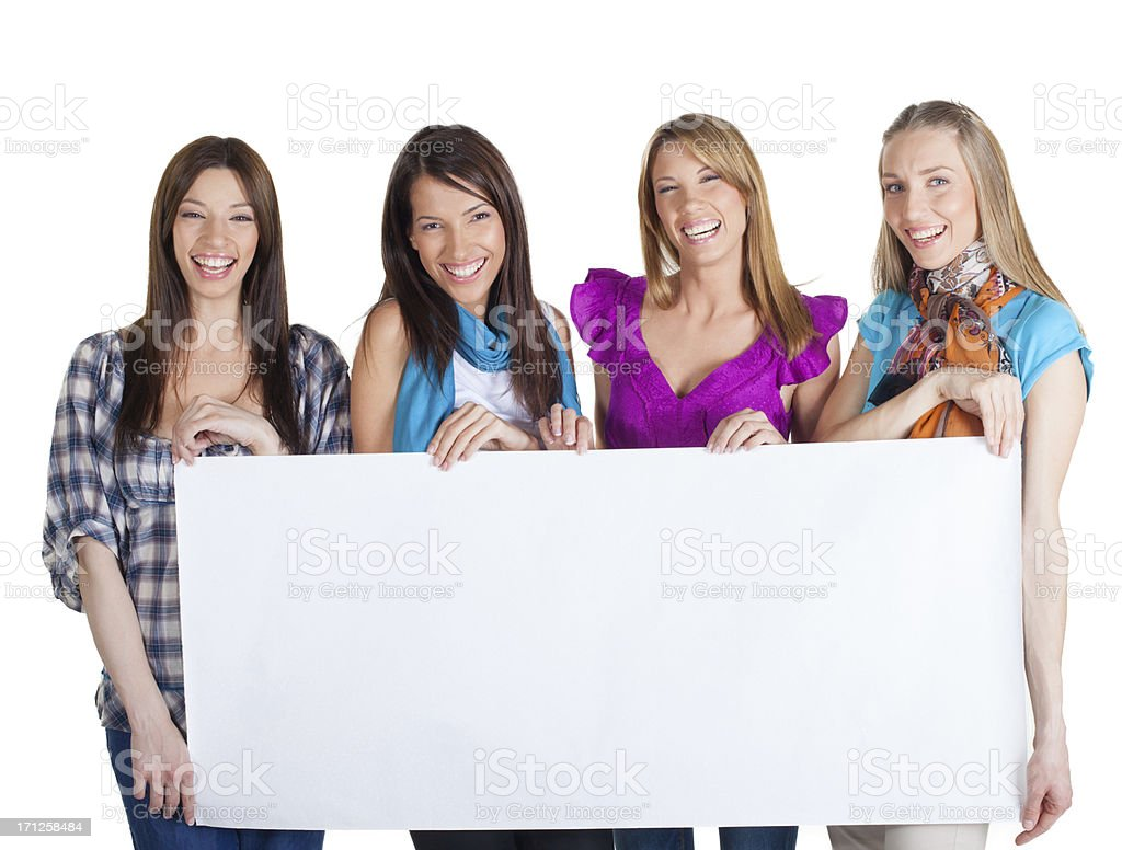 Cute happy casual dressed Women holding a blank white board royalty-free stock photo