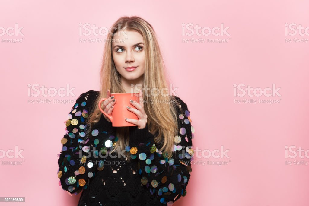 Cute happy girl hold coffee mug and looking up stock photo