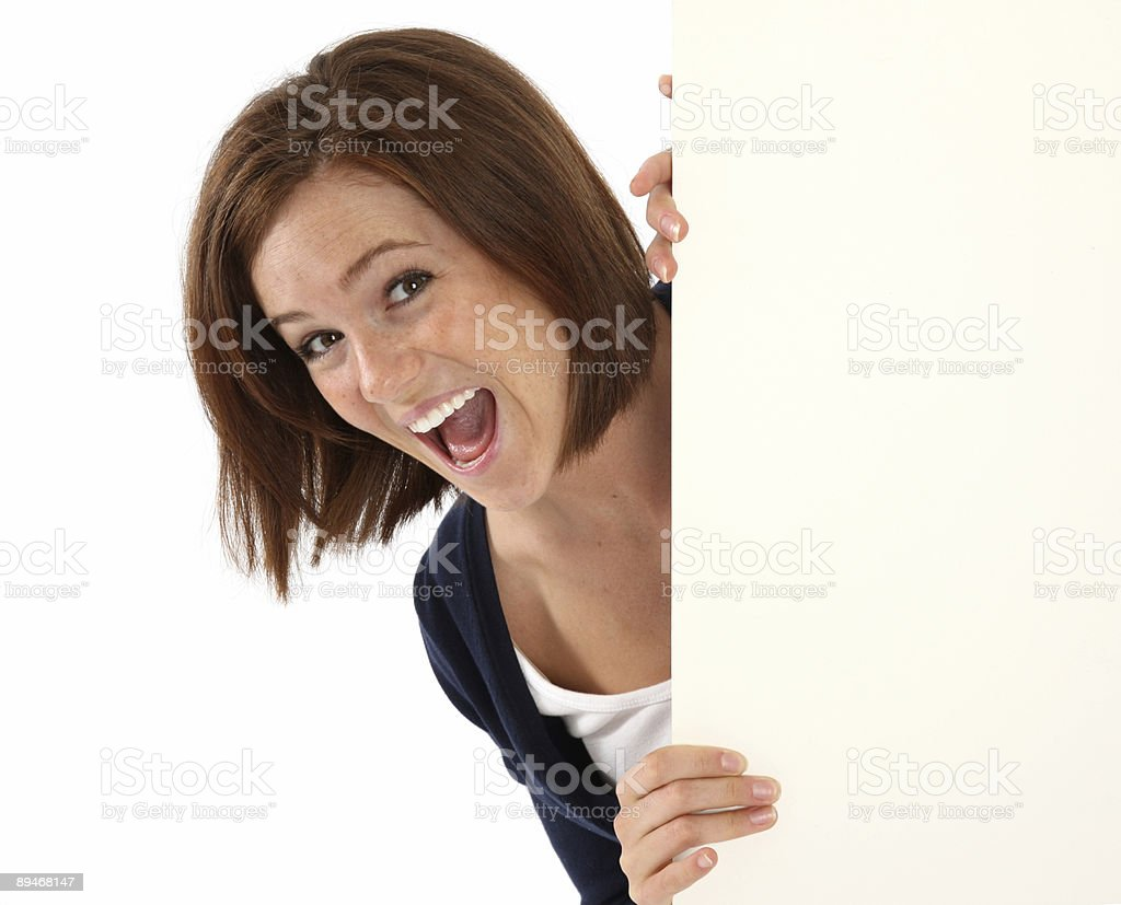 Cute happy girl looking around a corner royalty-free stock photo