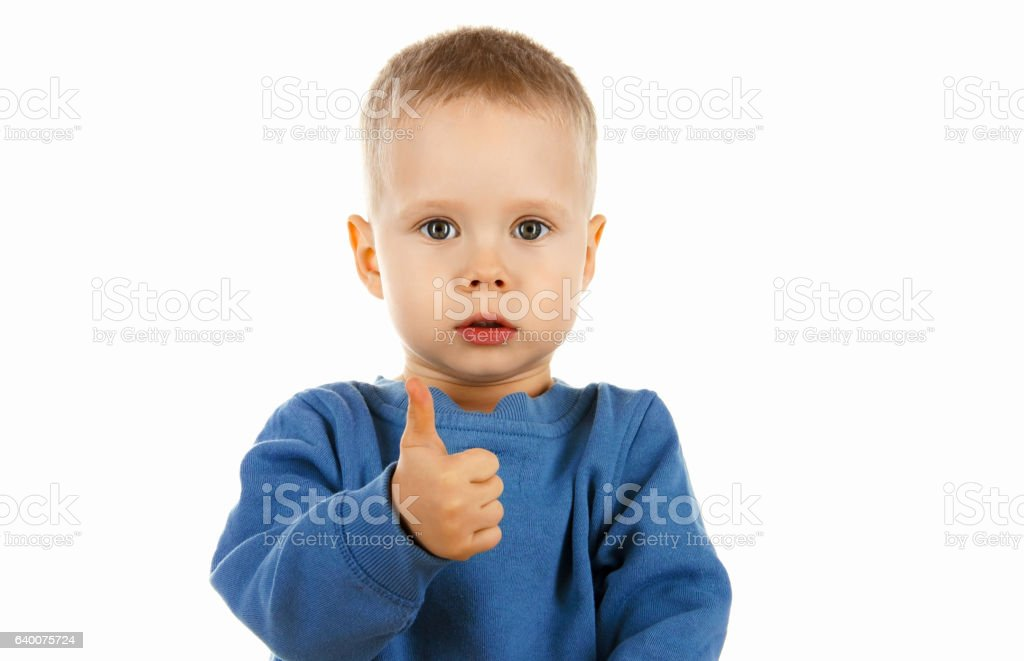 cute happy kid showing thumbs up everything is OK, stock photo