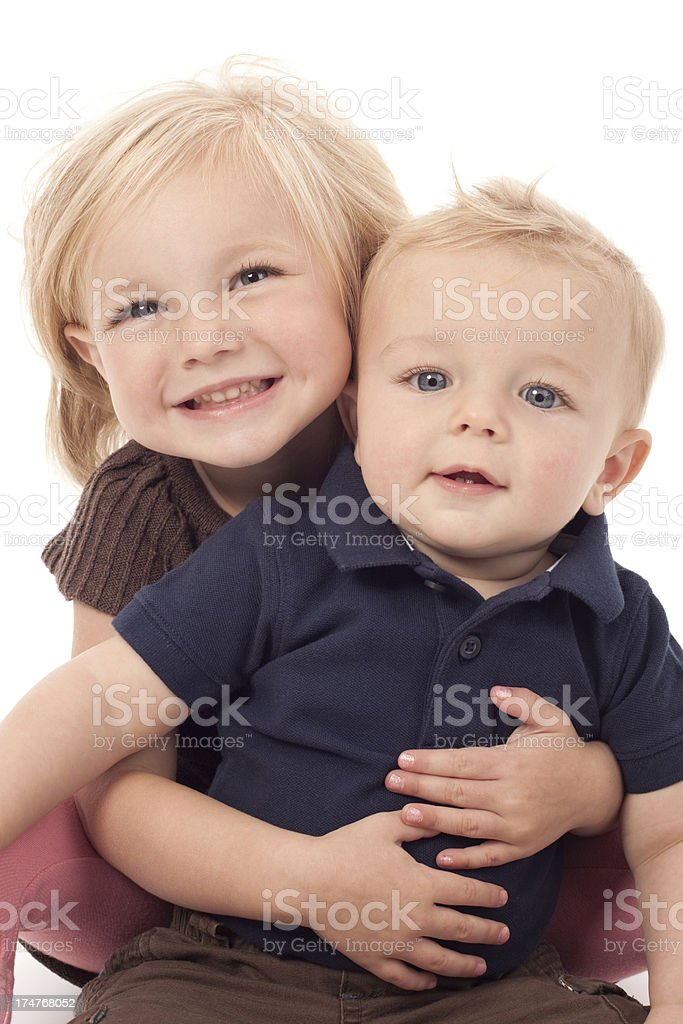 Cute Happy Little Girl Holding Smiling Baby Brother royalty-free stock photo