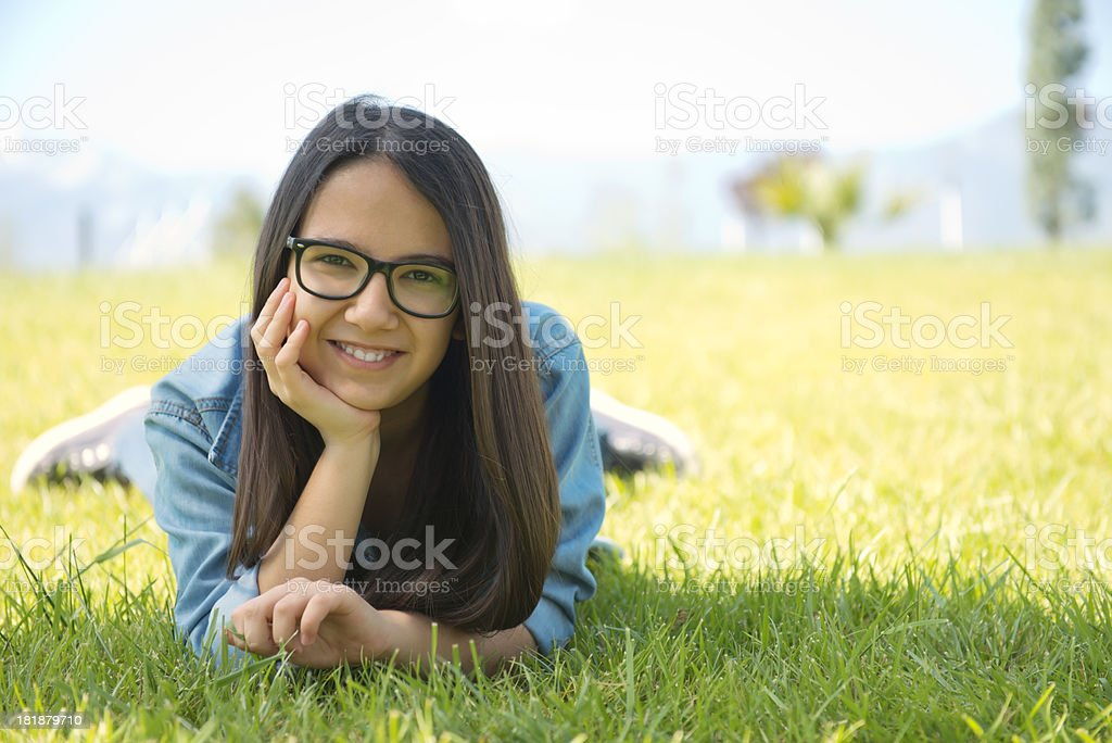 Cute happy little girl lying on the grass royalty-free stock photo