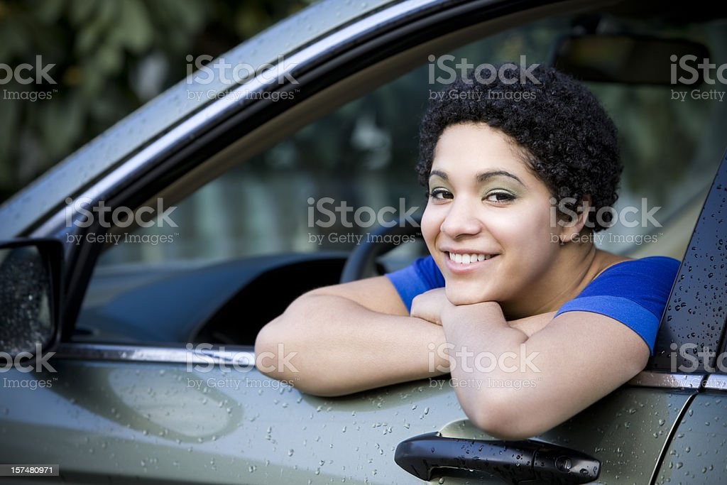 African American Teenager Smiling in Car Driver Seat, Copy Space royalty-free stock photo