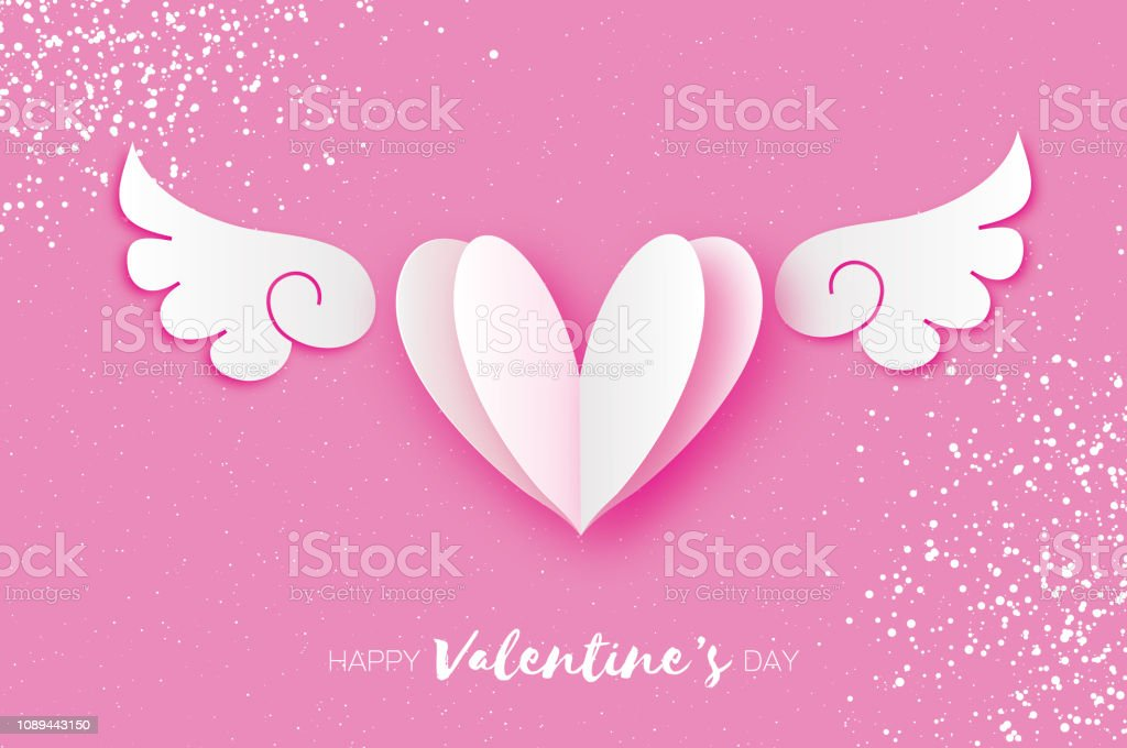 Cute Happy Valentine's Day Greetings card. White Origami angel wings and romantic heart. Love. Winged heart in paper cut style. Pink background. 14 February. stock photo
