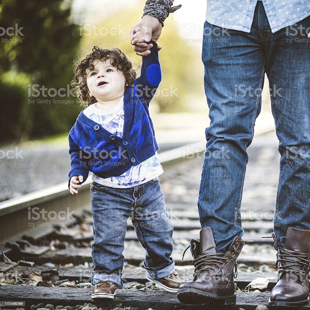 Cute Hispanic Boy Holding Dads Hand royalty-free stock photo
