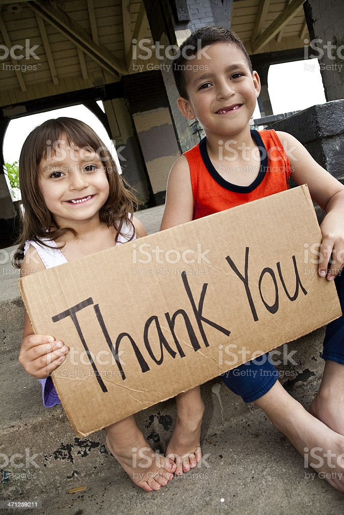 Cute Hispanic Children Holding 'Thank You' Sign royalty-free stock photo
