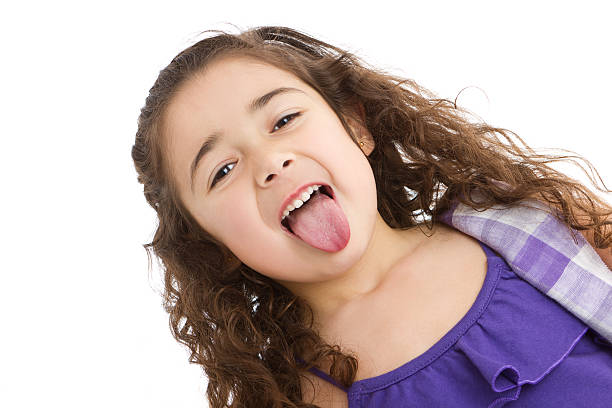 Best Little Girl Sticking Out Her Tongue Stock Photos ...