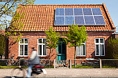 Little Traditional northern Brick house with photovoltaic technology on the roof