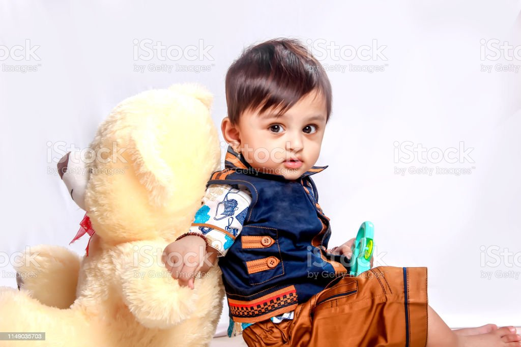 Cute Indian Baby Child Playing With Toy Stock Photo Download Image Now Istock