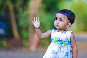 cute indian baby girl  playing in the park
