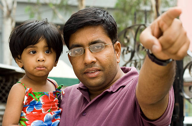 Cute Indian Child And Father.  little girl kissing dad on cheek stock pictures, royalty-free photos & images