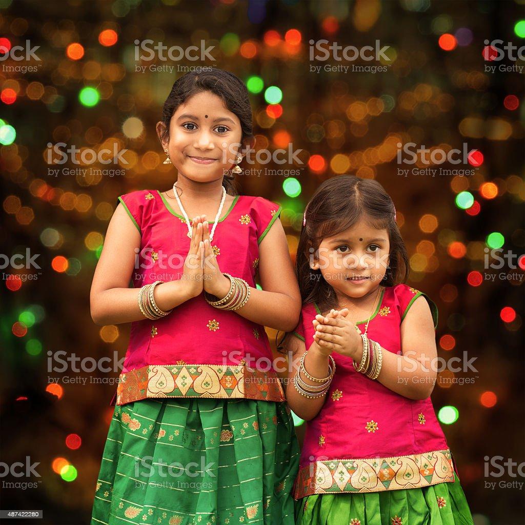 Cute Indian girls greeting stock photo