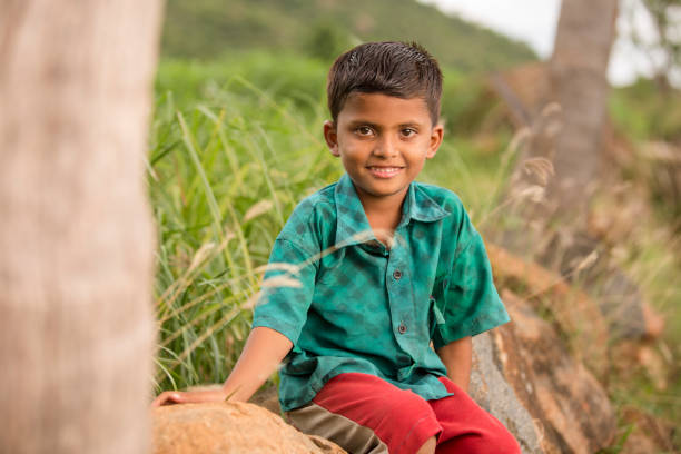 Cute Indian happy face village boy on farm field Cute Indian happy face village boy on farm field, Tamilnadu, India. university of missouri columbia stock pictures, royalty-free photos & images