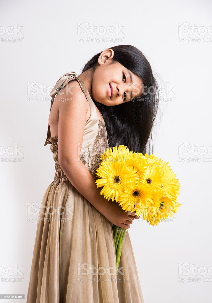 Cute indian little girl holding yellow flowers stock photo more cute indian little girl holding yellow flowers royalty free stock photo mightylinksfo