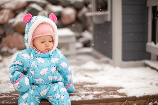 cute infant in the snow