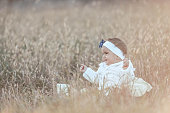 Smiling baby girl siting in park