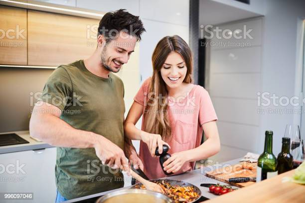 Cute joyful couple cooking together and adding spice to meal laughing picture id996097046?b=1&k=6&m=996097046&s=612x612&h=8 pekxrc jvxyp2c6vt35krbur4t4sijur wkots00a=