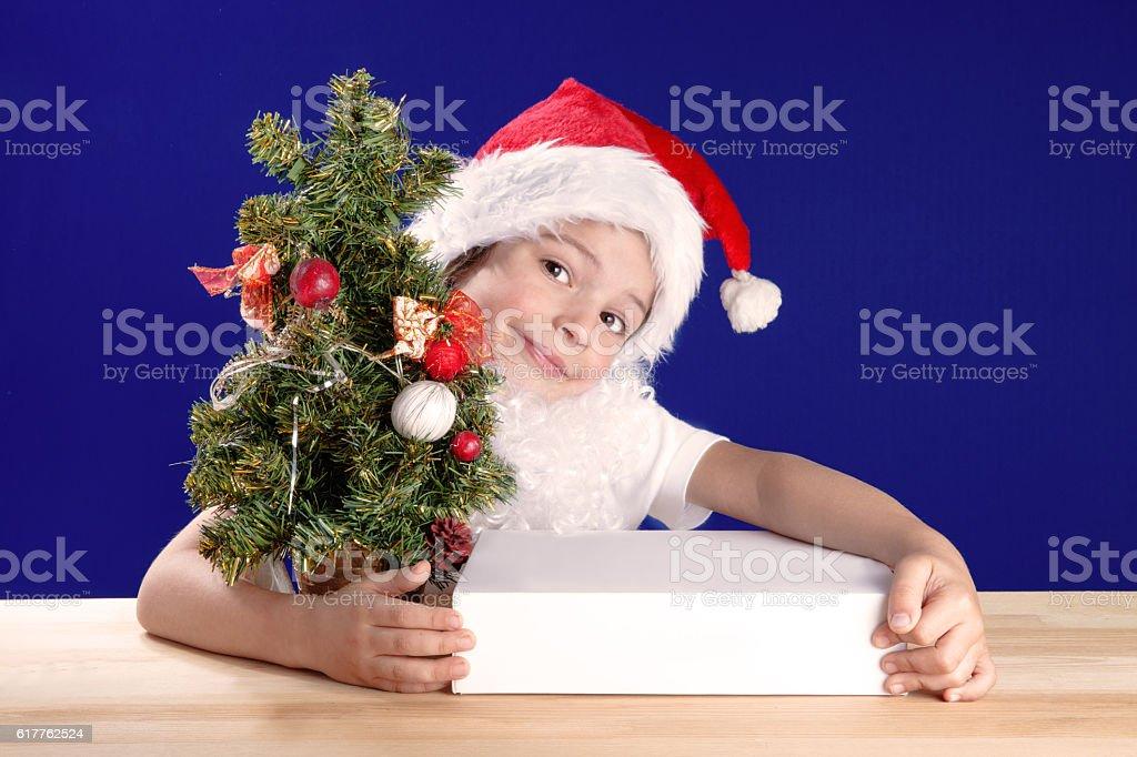 Cute Kid Dressed As Santa Claus Hugging Their Christmas Gifts Stock ...