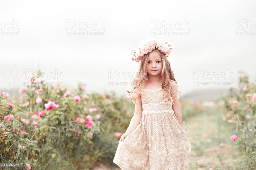 Cute kid girl outdoors stock photo