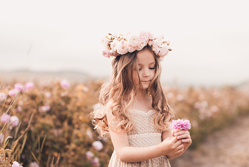 Cute kid girl posing outdoors