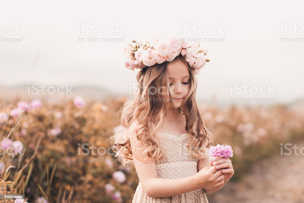 Cute kid girl posing outdoors stock photo