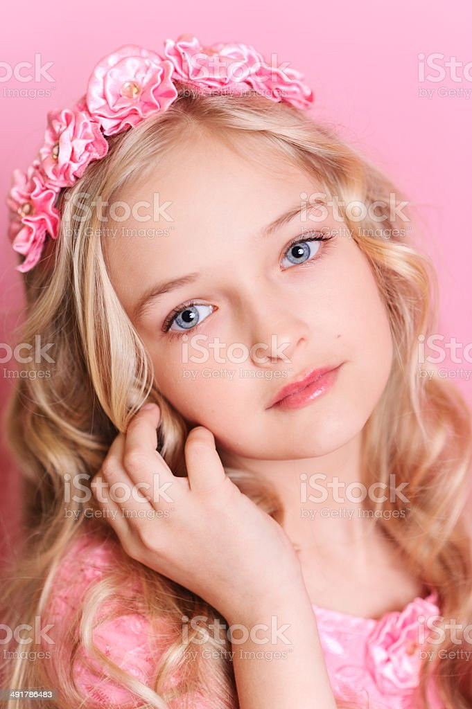 Cute kid girl posing over pink stock photo