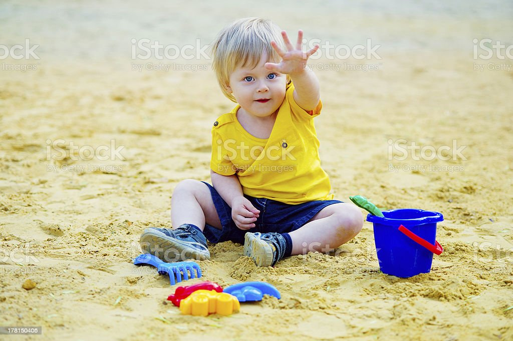 Cute kid in the sandpit stock photo