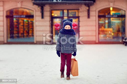 istock cute kid on shopping in winter season 868436376