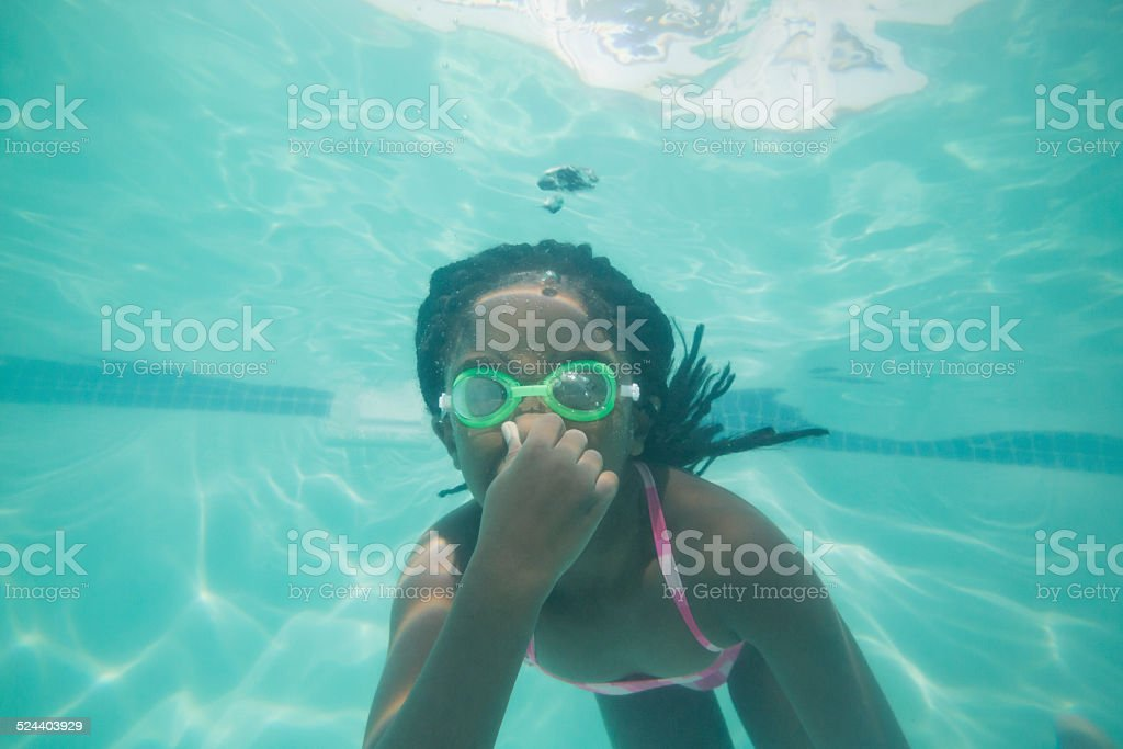 Cute kid posing underwater in pool stock photo