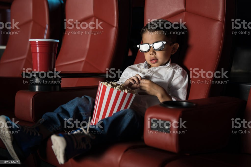 Cute kid watching a 3D movie stock photo