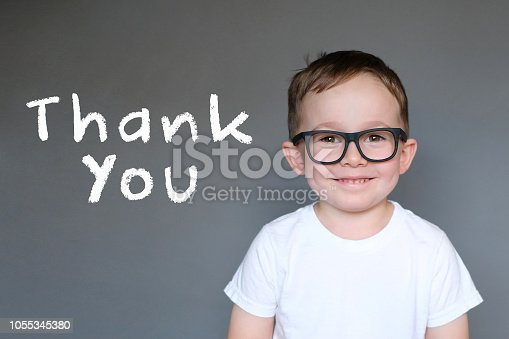istock Cute Kid with a Thank You message 1055345380