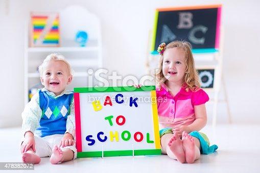 istock Cute kids at preschool painting. Back to school 478382072