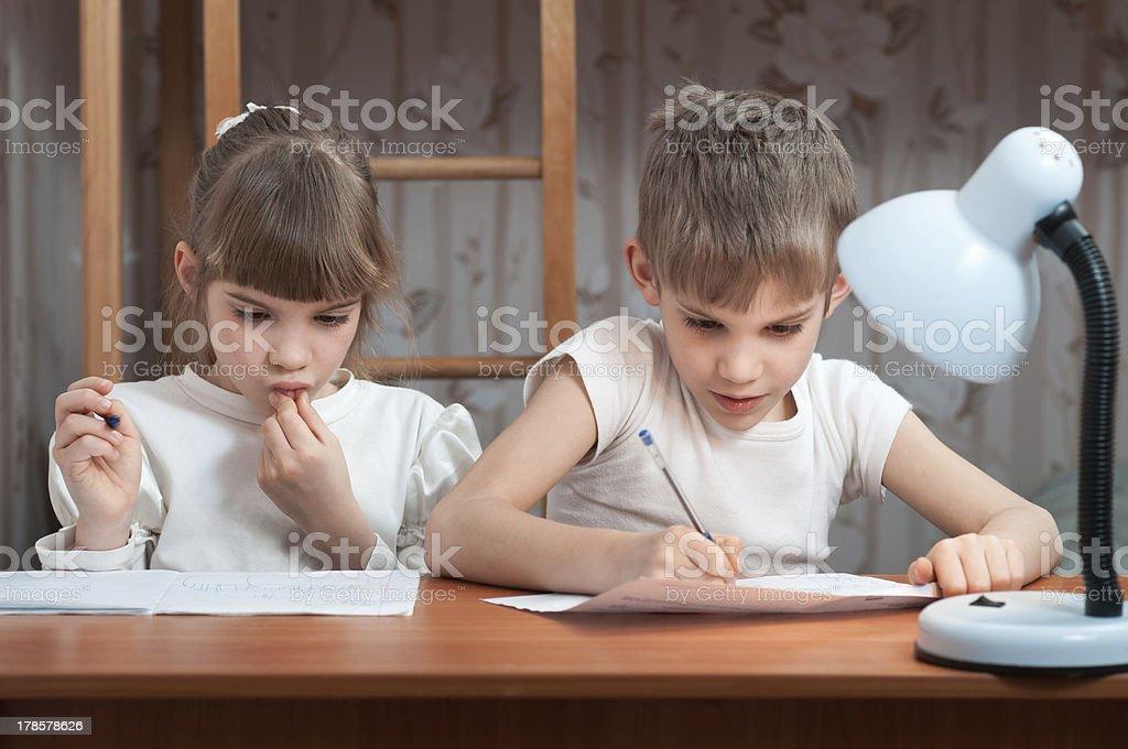 cute kids do their homework royalty-free stock photo