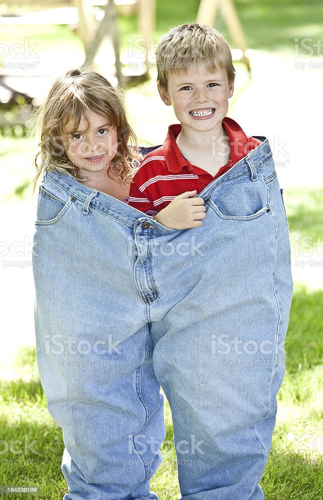 Cute Kids in Oversize Jeans royalty-free stock photo