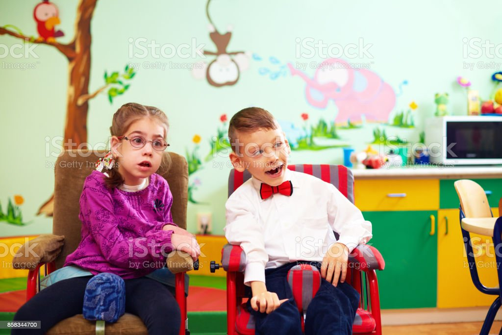 cute kids in wheelchairs at kindergarten for children with special needs - foto stock